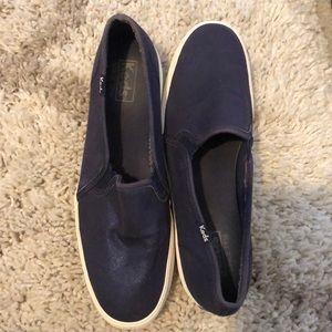 Keds slip on sneakers.